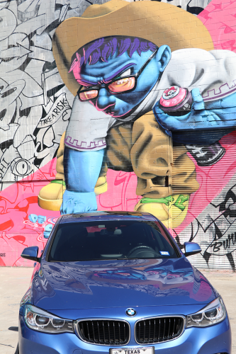 Colorful mural and blue BMW in East Downtown, Houston, Texas