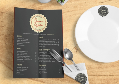 Simon's Bistro menu with ivory, red and charcoal brand and attractive typography